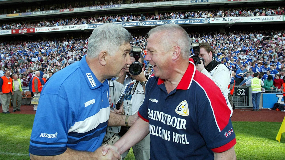 Managing Westmeath, Paidi O'Se shares a laugh with Laois manager Mick O'Dwyer after the Leinster Football Championship Final in 2004