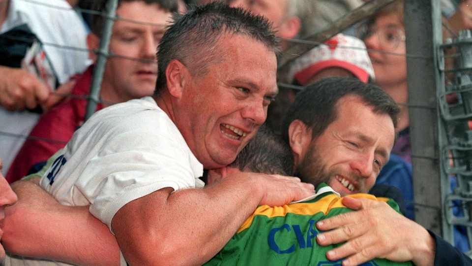 Sean Kelly embraces Paidi O'Se after one of 11 Munster title wins