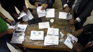 Polling station officials count ballots in Cairo