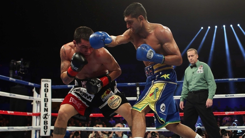 Amir Khan of Great Britain (right) throws a right hand at Carlos Molina during their vacant WBC silver super lightweight title fight at Los Angeles Sports Arena