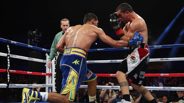 Amir Khan lands a right hand to the body of Carlos Molina