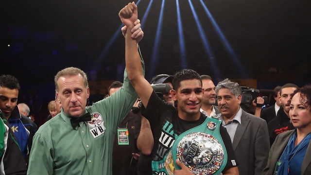 Amir Khan poses with referee Jack Reiss following his vacant WBC silver super lightweight title fight victory over Carlos Molina