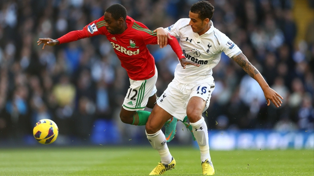 Nathan Dyer of Swansea City and Kyle Naughton of Tottenham Hotspur