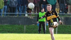 Colm Cooper kicks a point for Dr Crokes