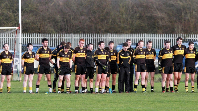 The Dr Crokes team observe a minutes' silence for Páidí Ó Sé at today's game