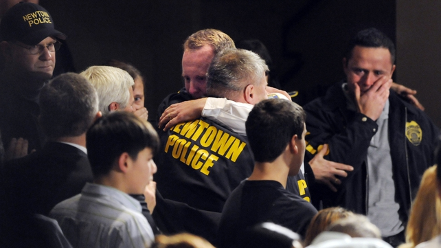 Newtown first responders received a standing ovation as they entered the auditorium for a vigil