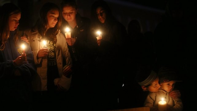 Residents of Newtown, Connecticut, last night attended a vigil in memory of those who died