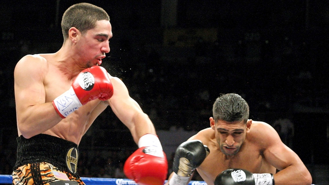 Danny Garcia lands a left on  Amir Khan