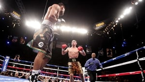 Danny Garcia (right) advances on  Amir Khan at the Mandalay Bay Events Center in Las Vegas