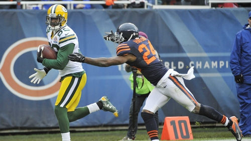 James Jones of the Green Bay Packers catches a touchdown as Kelvin Hayden of the Chicago Bears defends him at Soldier Field