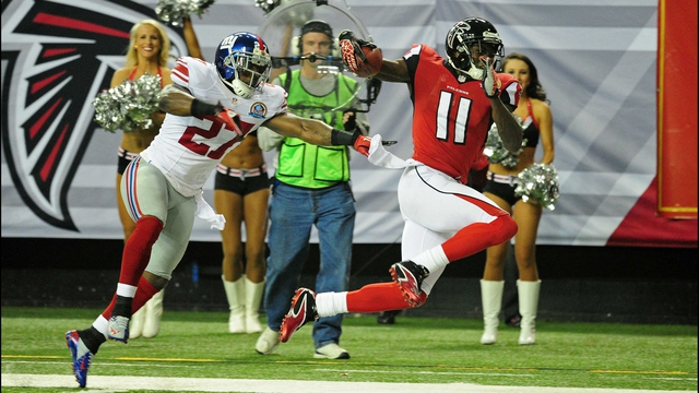 Julio Jones of the Atlanta Falcons runs with a catch against Stevie Brown of the New York Giants