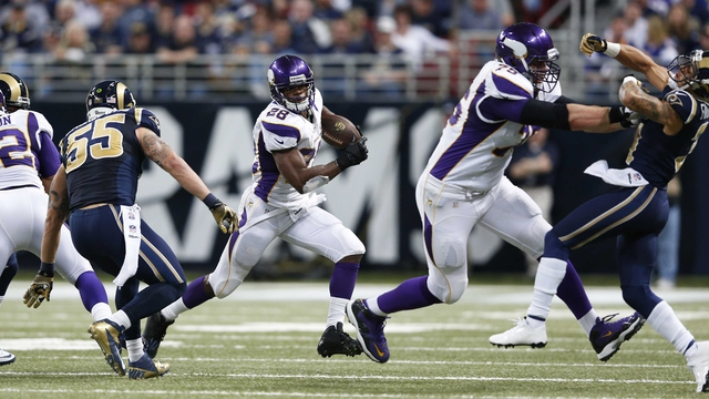 Adrian Peterson of the Minnesota Vikings runs with the ball against the St. Louis Rams