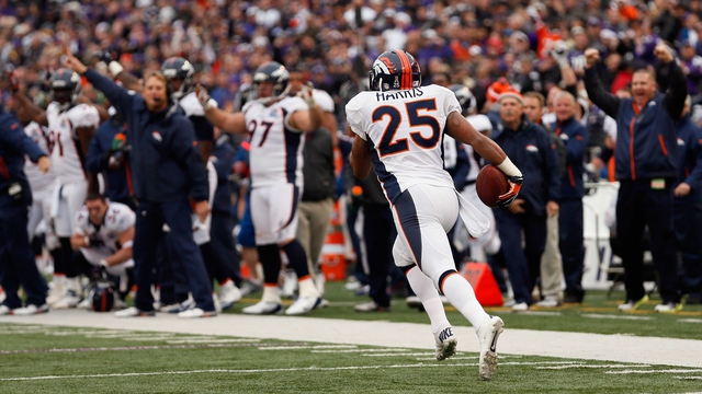 Cornerback Chris Harris of the Denver Broncos returns an interception for a touchdown