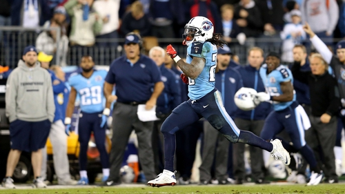 Running back Chris Johnson of the Tennessee Titans runs with the ball to score a 94-yard touchdown