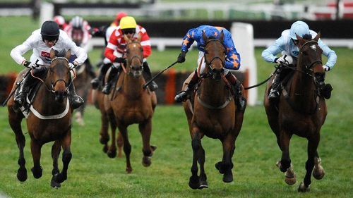 Barry Geraghty riding Mossley (left) clears the last to win The Albert Bartlett Novices' Hurdle Race at Cheltenham