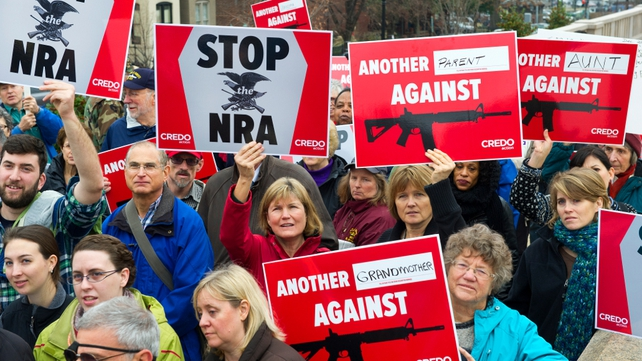 Protesters descend on the Washington offices of the National Rifle Association