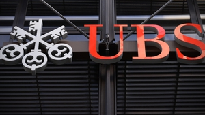 Gains in its advisory business softened an investment banking fall for UBS