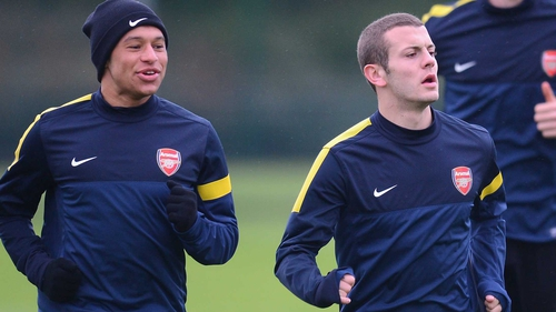 Alex Oxlade-Chamberlain and Jack Wilshere (r) have extended their stays at the Emirates