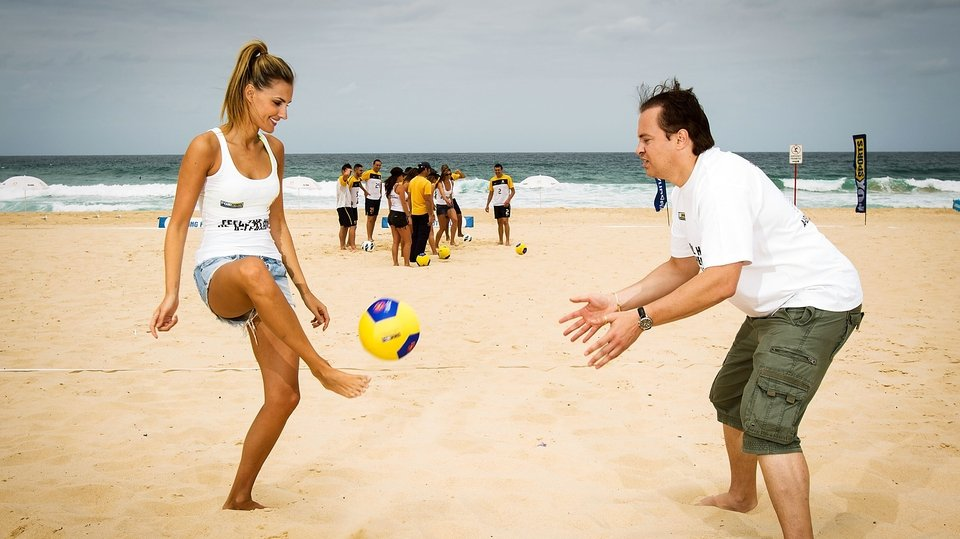 'Eye on the ball, Mark' - Former Man United and Aston Villa goalkeeper Mark Bosnich putting Former Miss Universe Australia Laura Dundovic through her paces at the FFA Summer Football launch at Maroubra Beach in Sydney