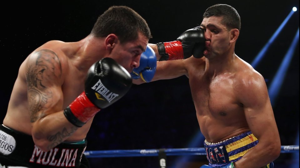 Khan he take a punch? Yes he Khan - Carlos Molina lands a left hand to the face of Amir Khan during their Vacant WBC Silver Super Lightweight title fight at Los Angeles Sports Arena