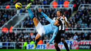 One for the cameras - Man City striker Carlos Tevez attempts an 'Ibrahimovic' at St James' Park