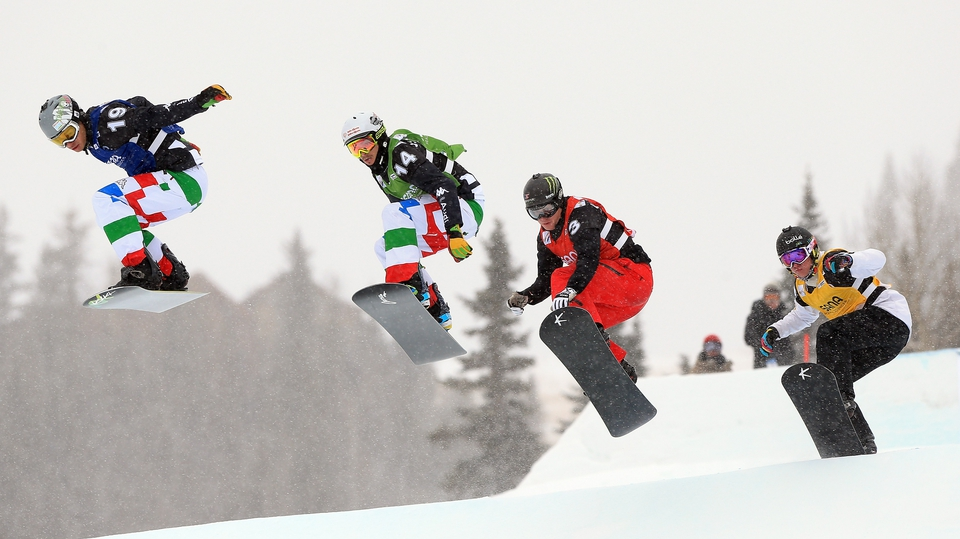 Italy's Omar Visintin and Luca Matteotti, Nate Holland of the USA and Jarryd Hughes of Australia compete at the USANA Snowboardcross World Cup in Telluride, Colorado