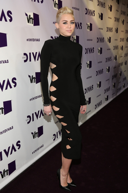 Miley Cyrus debuted her new extreme pixie peroxide cut on the red carpet this week in a risqué bodycon gown with cut-out detail from Omo by Norma Kamali