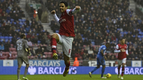 Mikel Arteta and Arsenal take on Bundesliga leaders Bayern Munich tonight