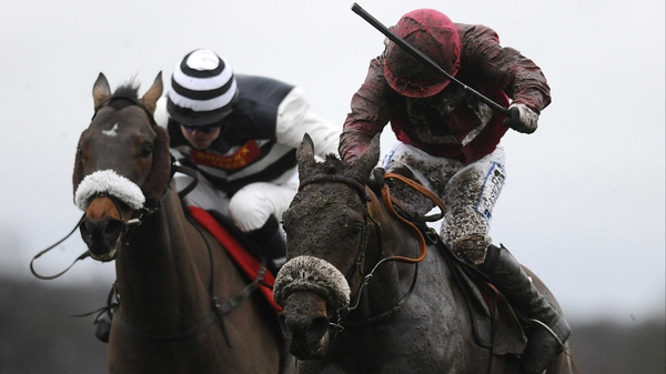 Davy Condon drives Cause Of Causes (right) to victory in the Ladbroke Hurdle