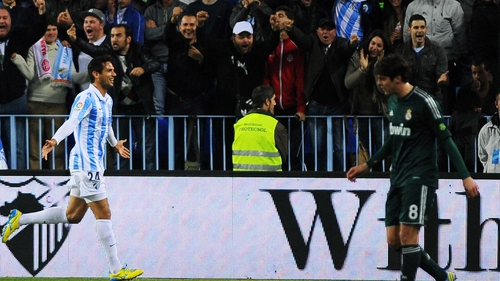 Roque Santa Cruz scored twice for Malaga against out of sorts Real Madrid