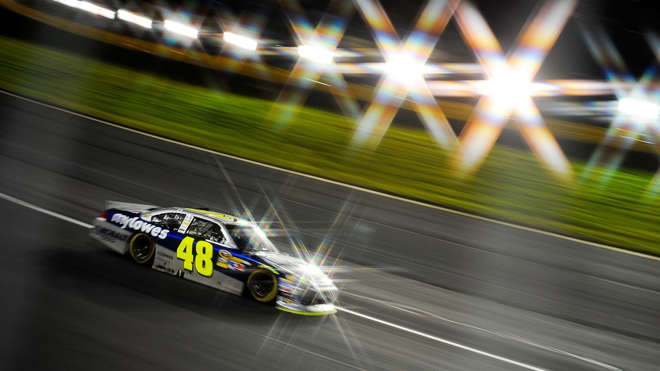 Jimmie Johnson, driver of the MyLowe's Chevrolet, races during the NASCAR Sprint Cup Series Bank of America 500