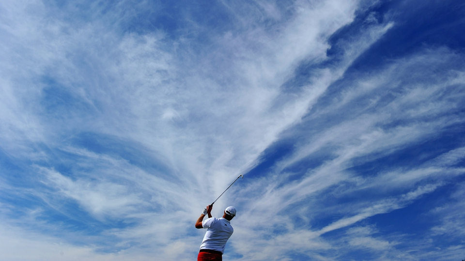 Fredrik Andersson Hed of Sweden splits the fairway - and the sky - at the Portugal Masters