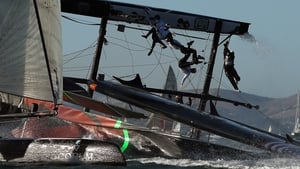 The Oracle Team USA skippered by James Spithill flips over during a fleet race in the America's Cup World Series