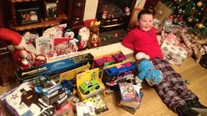 Five-year-old Luke McGettigan relaxes by the presents in Blanchardstown, Dublin 15