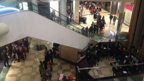 Bargain hunters queue outside Next in Dublin's Dundrum shopping centre this morning