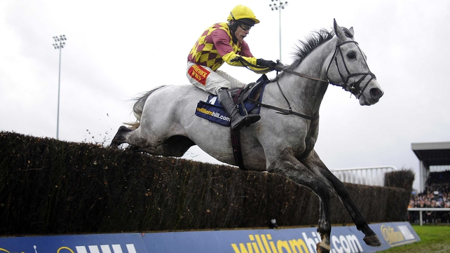 Tom Scudamore riding Dynaste clears the last to win The Kauto Star Feltham Novices' Steeple Chase at Kempton