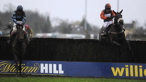 Sam Waley-Cohen riding Long Run (right) clear of the last to win the William Hill King George VI from Captain Chris (left) at Kempton