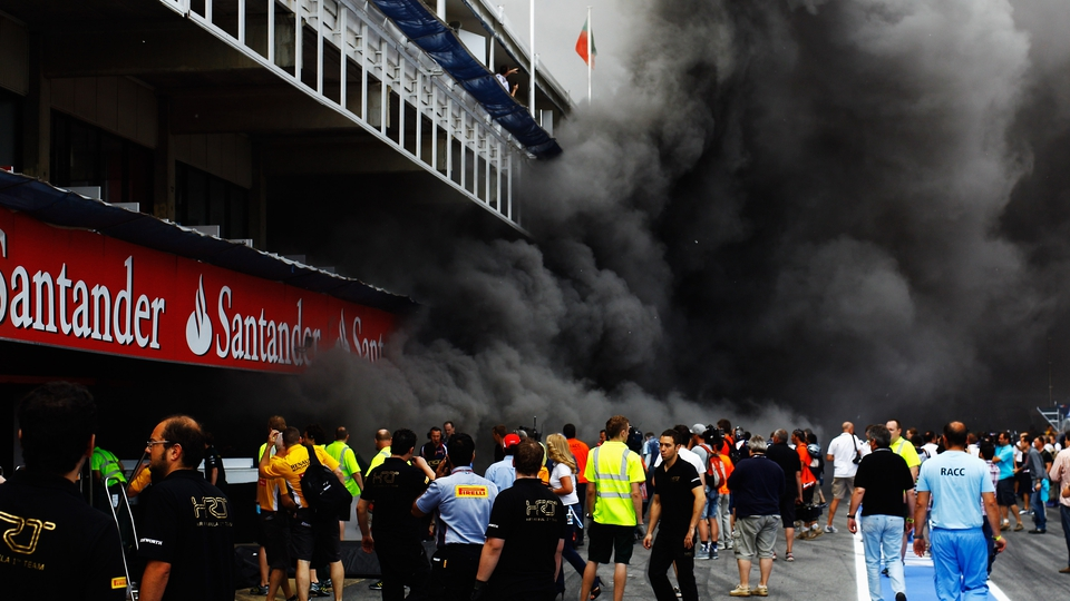 Fire breaks out at the back of the Williams team garage as they celebrate winning the Spanish Formula One Grand Prix