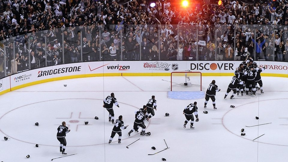 The Los Angeles Kings discard their helmets and sticks in celebration as they win the Stanley Cup in June