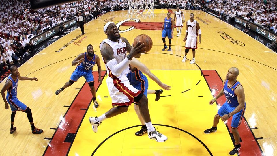 LeBron James soars for a slam dunk for Miami Heat against Oklahoma City Thunder