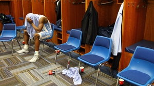 Dejection in the dressing room after the  NCAA Men's Basketball Midwest Regional Final