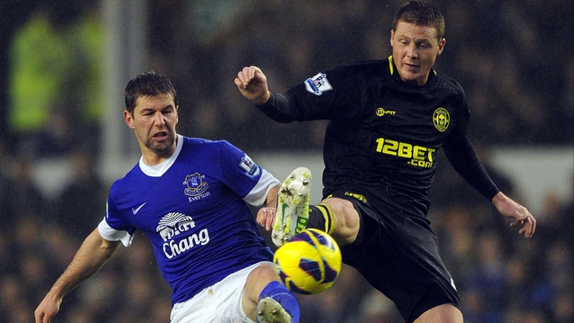 Thomas Hitzlsperger of Everton in action with James McCarthy of Wigan