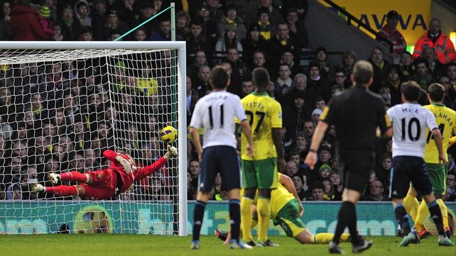 Chelsea's Spanish midfielder Juan Mata (second from right) scores the Blues' winner past the dive of Norwich's keeper Mark Bunn (left)