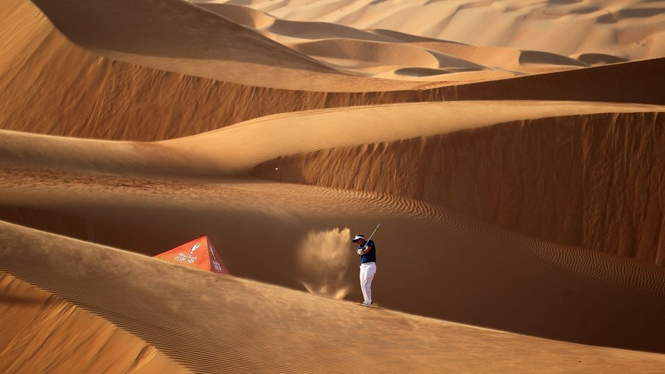 Luke Donald plays a shot amid 250ft sand dunes at the Abu Dhabi Golf Championship