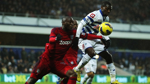 Marc-Antoine Fortune (left) of West Bromwich Albion and Shaun Wright-Phillips (right) of QPR