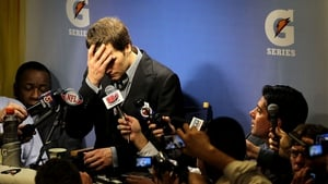 New England Patriots quarterback Tom Brady breaks down as he faces the media after losing to the New York Giants in Super Bowl XLVI