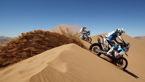 Michael Pisano of France rides over a sand dune during stage seven of the 2012 Dakar Rally
