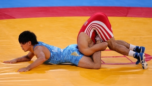 Ashraf Aliyev of Azerbaijan in an awkward position during the wrestling event