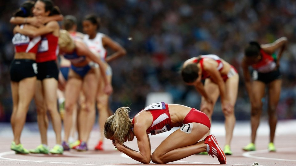 Morgan Uceny of the US is distraught after falling during the women's 1500m final