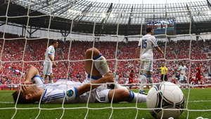 Kostas Katsouranis of Greece lies on the turf after the Czech Republic score